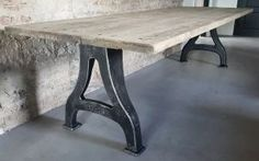 Industrial design table - cast iron base with reclaimed oak top. Can be customized in all measures up to 500cm length and 150cm width.