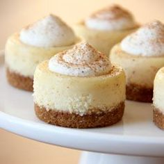 Mini eggnog cheesecakes topped off with homemade sweetened whipped cream and a dusting of nutmeg.