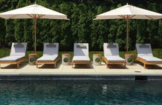 Modern outdoor pool furniture with custom striped cushions designed by S.