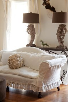 White linen slipcovered sofa with a sheer frill...full length cushion-do ruffle on chair/ottoman
