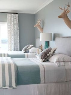 Relaxing Blue and Grey Bedroom- faux deer heads!