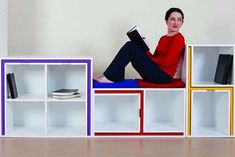"""As If From Nowhere"" bookshelf was created by Orla Reynolds, a recent graduate from the Dublin Institute of Technology in Ireland. The red, purple and yellow parts are a table and chairs! Slide them into their slots when not needed, and they dissapear - pull them out when you want them. Super duper cool."