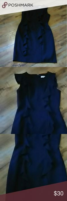 Calvin Klein dress size 6 Gorgeous navy blue dress with ruffle Embellishments period in the front and also in the back. This dress is absolutely stunning very well made fully lined is dress is in good condition 67% polyester 32% rayon 4% spandex lining 100% polyester this dress is 37 in Long Calvin Klein Dresses Midi