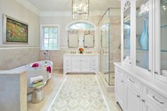 Transitional Master Bathroom with Crema Marfil 6x12 tile, Alexa Hampton Rose Triple Sconce in Polished Nickel with Crystal