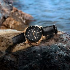 Panerai Luminor Submersible 1950, 42 mm case, red gold with a black ceramic disk on the rotating bezel.