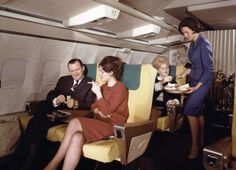 Mid 60s in the first class cabin of a Lufthansa Boeing 707 airplane.