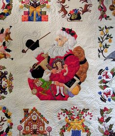 Baltimore Christmas by Sue Maitre, quilted by Linda Hrcka, 2014 AZQG.  Pattern by Pearl Pereira. Photo by Quilt Inspiration.