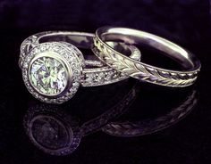 custom made bezel set diamond engagement ring with hand engraving and matching hand engraved wedding band