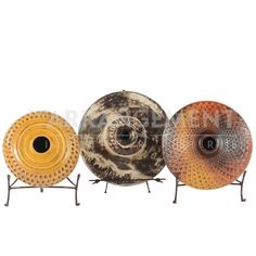 Unique Rounded Tribal Pottery  Looking for something no one else has? These three tribal pottery pieces are a great addition to any Southwestern or Rustic home. Colorful patinas, faded coloring, and textural details are what sets these pottery pieces apart. Set them on their stands and display on a console, a bookshelf, or above your kitchen cabinets.