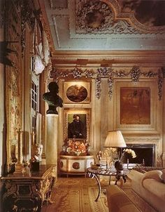 Beautiful French decor with cozy understated sitting room by Molyneux.