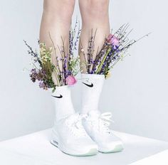 White nike with flowers in sock