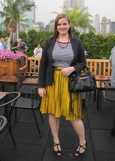 Striped shirt, colorful skirt.