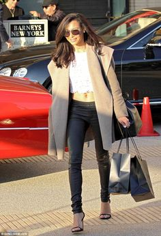 Last minute shopping: Glee star Naya Roberts showed off her amazing midriff while shopping at Barneys New York in Beverly Hiils, California ...
