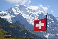 Photo about Swiss flag on the top of Mannlichen (Jungfrau region, Bern, Switzerland). Lausanne, Swiss Flag, Swiss Army, Work Abroad, Zermatt, By Train, France, International Airport, International Companies
