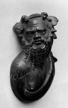 Bronze bust of satyr wearing ivy-wreath. Height: 12 cm.  © The Trustees of the British Museum
