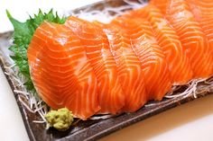 Salmon Sashimi // Verdict: Bought fresh salmon from the market...best decision ever. SO DELISH! Had it with roasted seaweed, rice, soy sauce & wasabi mix, and Sriracha sauce