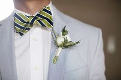 Seersucker suit, striped bow tie, and a white boutonniere! Photo: Love Me Do