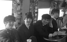 The Beatles on the train back from Washington DC, 12 February 1964. Photo by Joe Allen