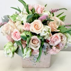 Roses, & Tulips, accented with some Dusty Miller greenery and pink Veronicas.
