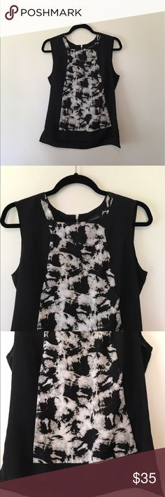 NWOT Cynthia Rowley Top NWOT Sleek and stylish tank that is perfect for work or with jeans. From a smoke free home and in excellent condition. Cynthia Rowley Tops Blouses