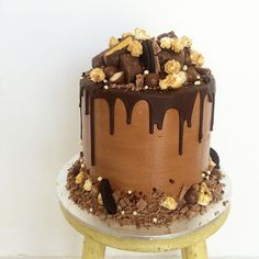 MAN CAKE Chocolate buttermilk cake layered with caramel buttercream, popcorn and oozy salted caramel covered in a Nutella frosting and topped with all sorts of chocolately goodness! @emmakilkeary