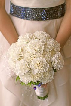 Pretty bouquet of white carnations :)  Loose bouquet- add some baby's breath and alstromeria??