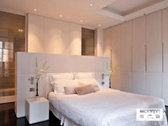 clean simple contemporary bedroom suite with ensuite shower room set behind the bed and banks of fabulous wardrobes to one side. Great lighting too! Hélène et Olivier Lempereur - Architecte décorateur Contemporary Bedroom, Modern Bedroom, Bedroom Decor, Bedroom Ideas, Contemporary Kitchens, Bed In Middle Of Room, White Bedroom, Master Bedroom, White Headboard