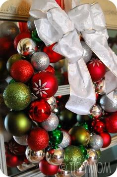 DIY Ornament Wreath. All you need is a wire hanger, ornaments and a hot glue gun.