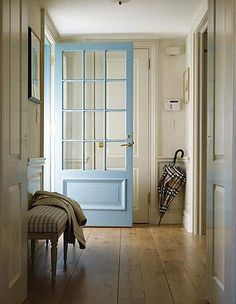 Pale blue, cream and oak make a smart and welcoming entrance hall.