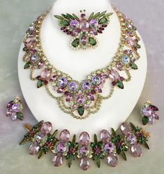 Sweet Lavender Parure - 2008  DiMartino Originals is the signature of a Tennessee artist who has been making jewelry for more than 20 years. She taught herself the almost-lost art of costume jewelry making; combining it with her copious artistic talent, she has created some of the most beautiful rhinestone jewelry. She uses primarily Swarovski Austrian crystal rhinestones, vintage and hand-painted cabochons, many of which are no longer being made.