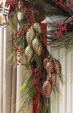 I like the pinecones grouped together-This would be a very easy DIY-It would look good with natural pinecones or spray painted.