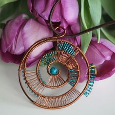NEW listing! Copper wire wrapped helix pendant with small turquoise beads. Copper Wire Jewelry, Wire Wrapped Jewelry, Wire Jewellery, Sell On Etsy, My Etsy Shop, Spiral Shape, Handmade Bracelets, Handmade Jewelry, Wire Weaving
