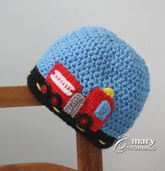 This hat is so much fun! A bright red fire engine is driving to the rescue!  This fire truck is created with all hand crochet and embroidery. A