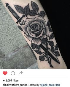 Black and gray dagger and rose tattoo by @jack_ankerson