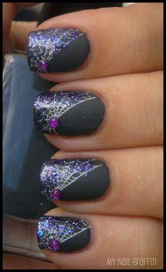 Halloween. Nail Art. Spiderweb nails with purple glitter and gemstones