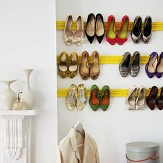 Hang your shoes by putting architectural plaster moldings on the wall as a rack!