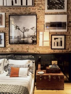 Oh I LOVE THIS!!!!! dNh23  gallery, brick wall, trunk + bedding, one exposed wall among emerald green walls by C@rol