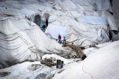 Rhone glacier in the central Alps of Switzerland is protected by blankets to minimize ice melt.