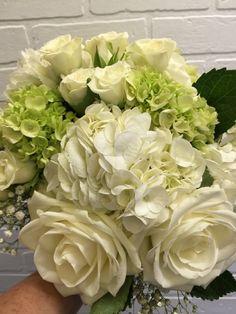 Bridal Bouquet of White Hydrangeas, Green Hydrangeas, White Roses and White Spray Roses.