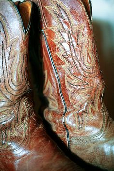 worn cowboy boots... My Durangos look like this, every scratch is a memory and the creases make them beautiful...