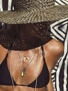 Straw hat, layered necklaces and a LBB
