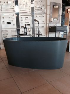 """coco blu∙stone™ freestanding bathtub Ideally proportioned for smaller spaces such as condo bathrooms, this compact 59"""" tub offers deep-soak capacity with a small footprint - holding an impressive 79G!"""
