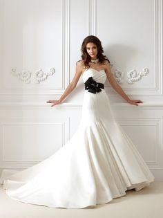 Strapless sweetheart neckline with vertical pleats on bodice and skirt and black sash... neat idea for the dres