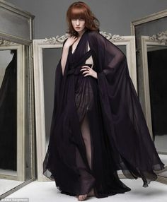 Very seductive, but could pull off the regal look as well if a different color. Love this dress!