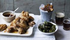 Smoky chilli chicken wings, spiced potato wedges and padron peppers recipe - BBC Food Chicken Wing Sauces, Chicken Wing Recipes, Spiced Potato Wedges, Sticky Chicken Wings, Yum Yum Chicken, Garlic Sauce, Stuffed Peppers, Spices