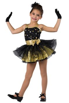 Style# 17105 STOLE THE SHOW - GOLD Glitter printed mesh over black spandex and metallic spandex leotard with attached black chiffon top skirt with fishing line curly hem. Separate sequined boucle over chiffon skirt. Bow trim. Headpiece included. XSC-XXLA G12-Short black gloves, optional.