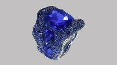 Fine-quality blue sapphires in larger sizes are rare, but they're still more available than ruby. The incredible blue sapphire in the center of this ring weighs 18.79 carats. - Vagabonde Bleue Ring © 2011 Fabergé Ltd.