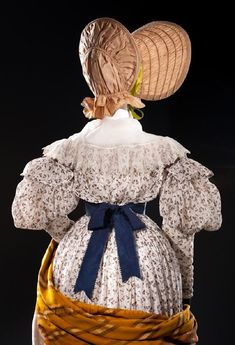 Dress, Europe or United States, c. 1835; Bonnet, Great Britain or Europe, c. 1830; Cap, c. 1830s; Collar, Europe, c. 1820-40; Shawl, Europe, c. 1835; Purse, Europe, c. 1830; all Helen Larson Historic Fashion Collection. Buckle, Europe, c. 1830-39, Gift of Jay Hampel