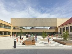 The new architectural concept of the Christian-Bucher-Gasse elementary school dating back to the 1950s, combines the existing structure with the new buildings into a harmonious, functional school complex with a large, protected inner courtyard. Photos: © Kurt Hoerbst #school #context #architecutre #education #courtyard #refurbishment School Date, Sport Hall, Elementary Schools, Architecture Design, Street View, Construction, Christian, Education, Gallery