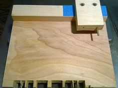 This is my box joint jig based off Woodfather's design  which is used with a single rip blade. It has a pin that matches your blade's kerf a...